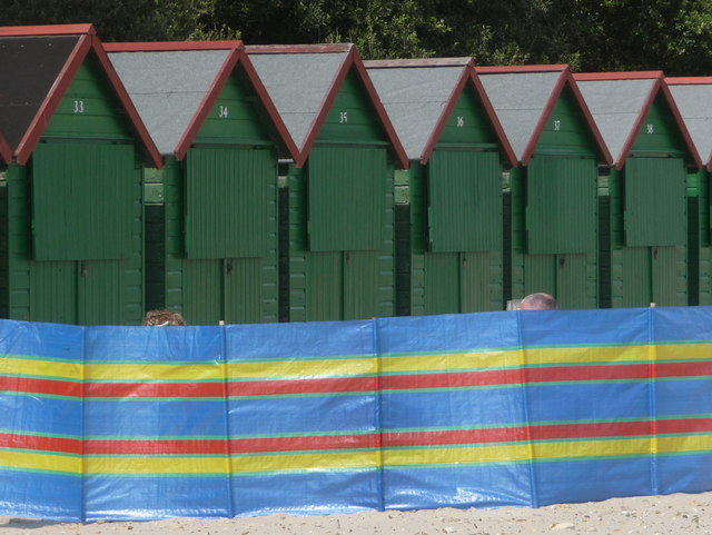 Mudeford: six beach huts and a windbreak