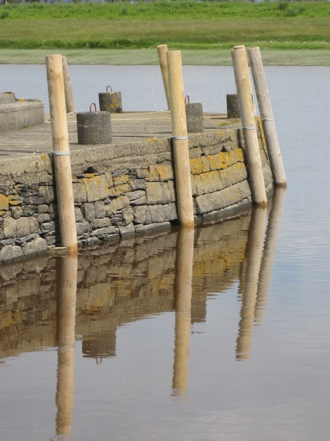 Mooring posts and reflections at Wigtown Harbour