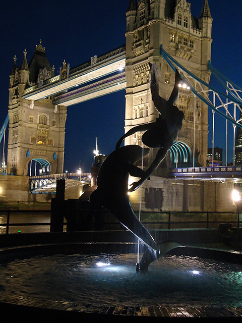 Tower Bridge and statue at night
