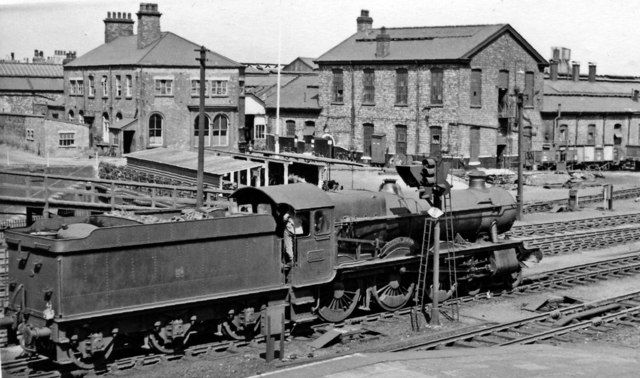 A GW 'Hall' passes the entrance to Crewe North Locomotive Depot