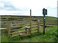 SK2387 : Stile and footpath sign by Graham Hogg