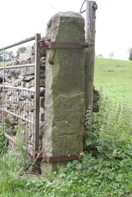 Benchmark on gatepost on west side of track