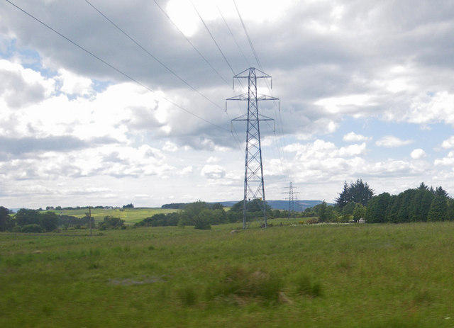 Power lines over grassy fields