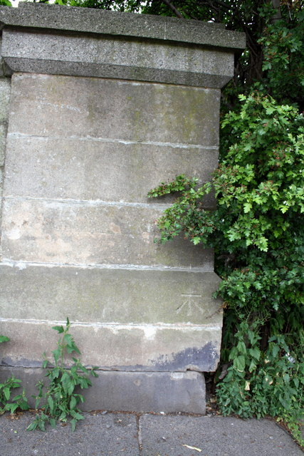 Benchmark on west end of south parapet of Botcherby Bridge