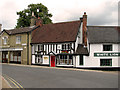 TM3877 : Shops and restaurants in the Thoroughfare, Halesworth by Evelyn Simak