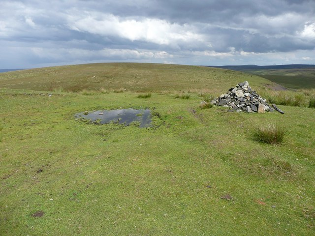 Cairn and puddle near Rough Hill