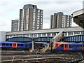TQ2775 : Trains under the footbridge, Clapham Junction by Christine Johnstone