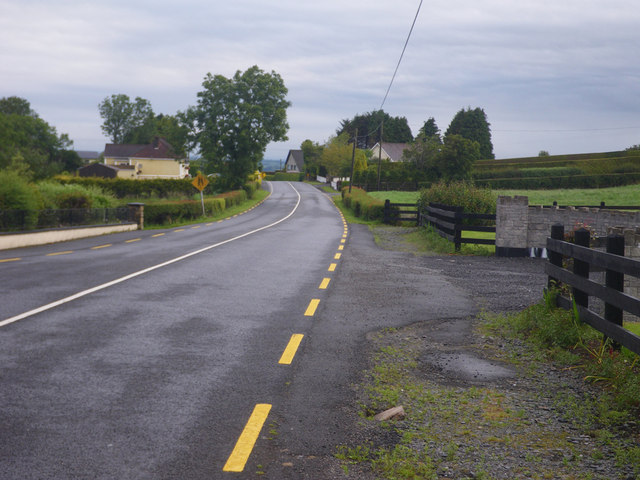 Rural residential area along the minor road
