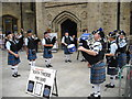 NZ2742 : Pipe Band entertaining tourists in Market Place by rob bishop