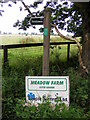 TM4062 : Meadow Farm &amp; Bridleway signs by Adrian Cable