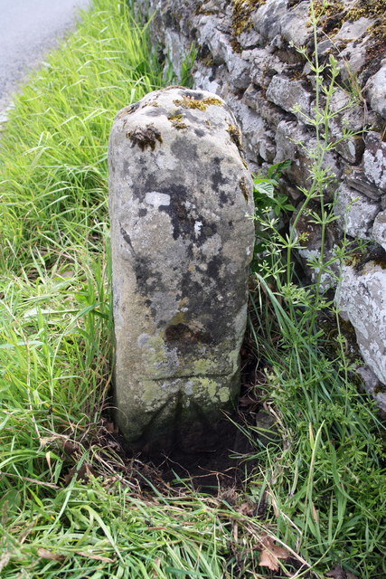 Benchmarked stone beside wall at Yoredale Cottages