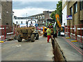 TQ3076 : Trenching in Stockwell Park Road by Robin Webster