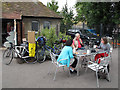 TQ3774 : Cyclists outside a cafe by Stephen Craven