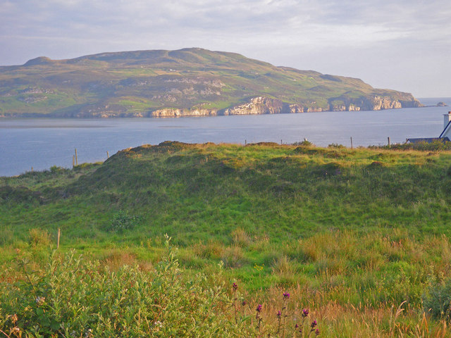 Grassy coastal prairie with Horn Head beyond