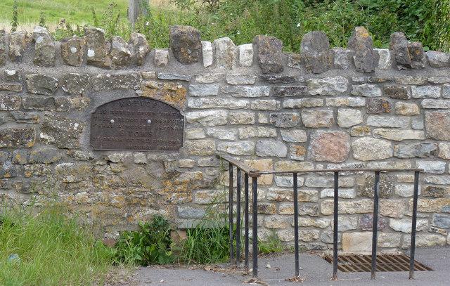 Sign beside road in Doynton village