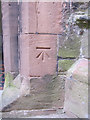 SO5174 : Bench mark on the church of St Laurence by John S Turner