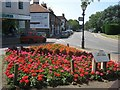 TQ4464 : Flower Display beside Farnborough High Street by David Anstiss