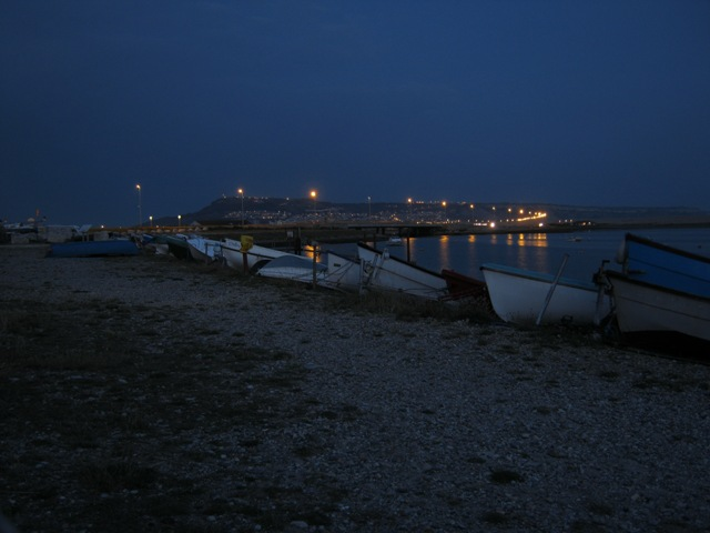 Beached boats on the Fleet at dusk
