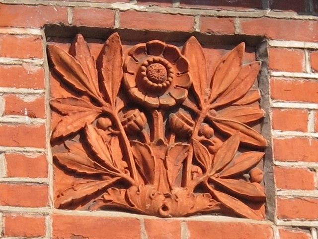 Decorative bas relief stonework on houses in Christchurch Avenue, NW6