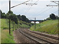 TM1234 : Rails, Catenary and Bridge by Roger Jones