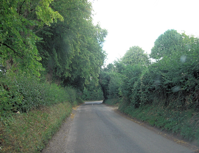 Lane approaches T-junction with Hill Road