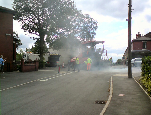 Laying tarmac on Dowson Road