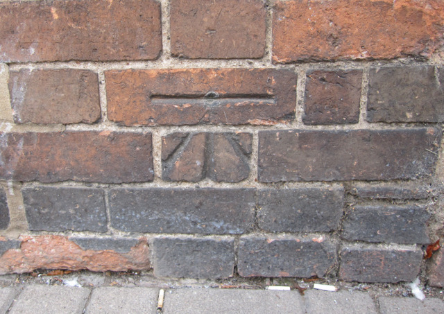 1GL bench mark and bolt on #3 Ely Street