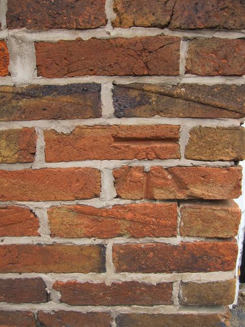 Bench mark on #1 Laburnum Cottages, Grove Road