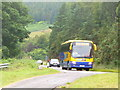 NH1689 : Bus at Creag Aimhreidh by Colin Smith