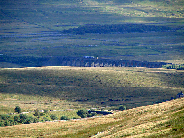 A passenger train crossing Ribblehead Viaduct
