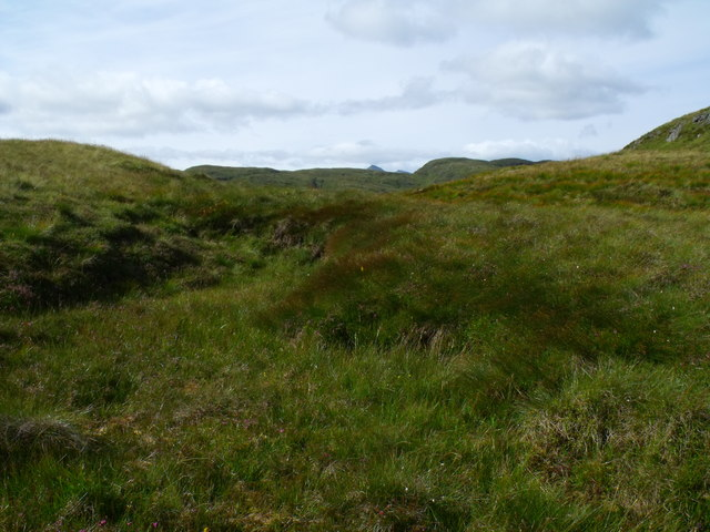 Peat slough on tiny bealach between ridge knolls on Beinn Bhreac