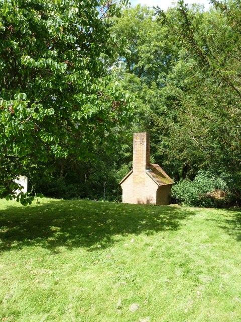 St Nicholas, Leckford: unusual shed in the churchyard