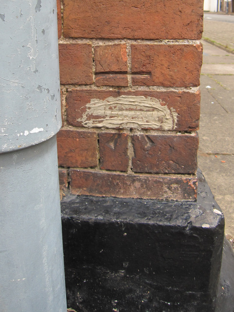 Altered bench mark on #1 Payton Street