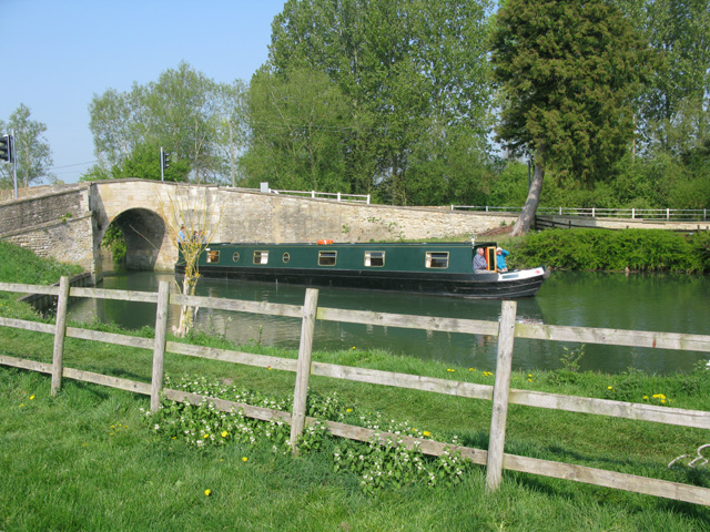 Narrow boat passing under Canal Bridge, Radcot