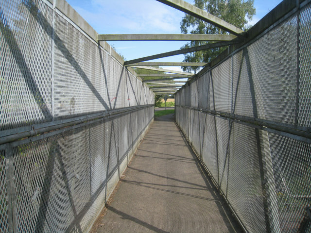 Caged footbridge