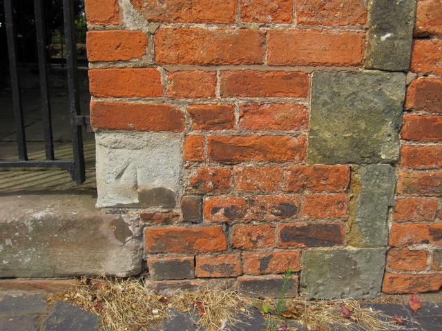 Damaged bench mark in Chapel Lane