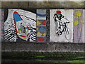 TQ2481 : Mural under canal bridge - boat, cyclist by David Hawgood