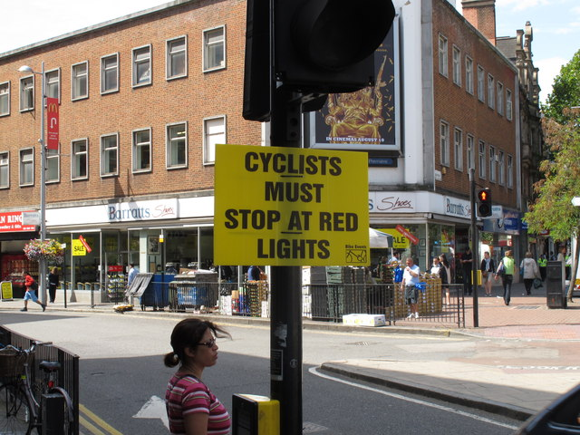 """""""Cyclists must stop at red lights"""" notice"""