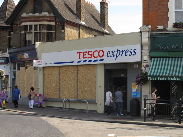 Ealing shops boarded up after riots