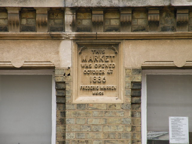 Plaque on former market gates