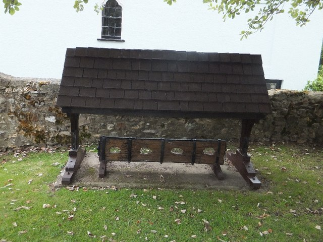 The wooden stocks in the churchyard at Ottery St Mary