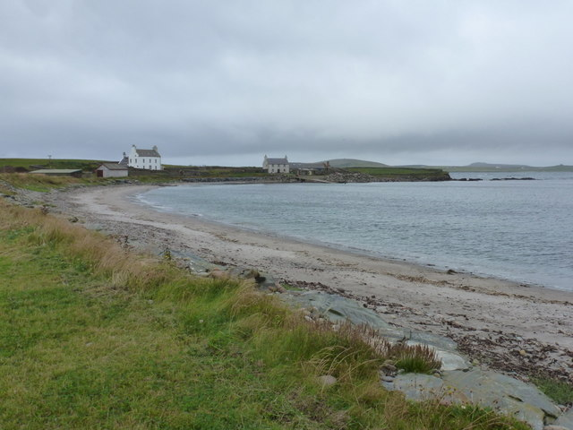 Sandness: view along the shore to Melby House