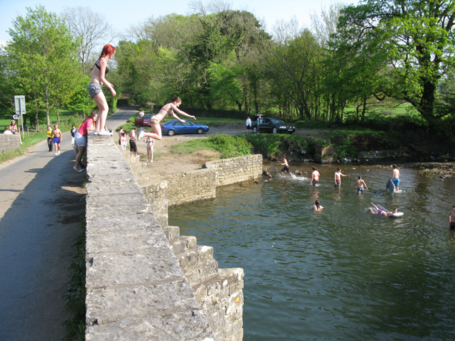 People jumping into the Ogmore River from New Inn Bridge