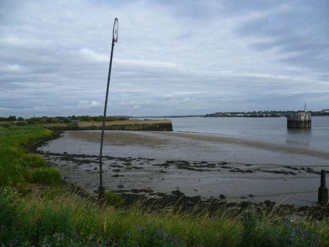 Muddy bay at low tide