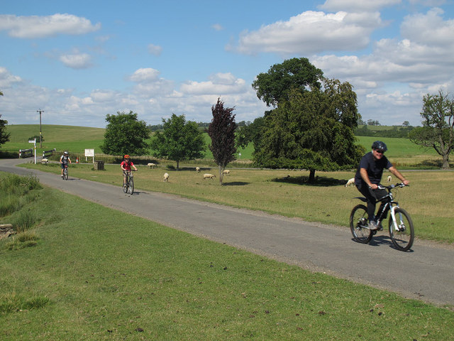Cyclists passing Launde Abbey