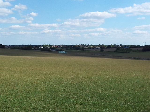 Looking across farmland to Howe Farm and the A1120