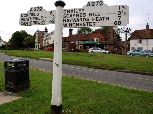 Signpost on Newick Green showing distances to two cathedral cities