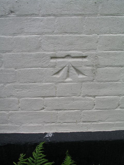 Cut bench mark with bolt on Southwold, United Reformed Church
