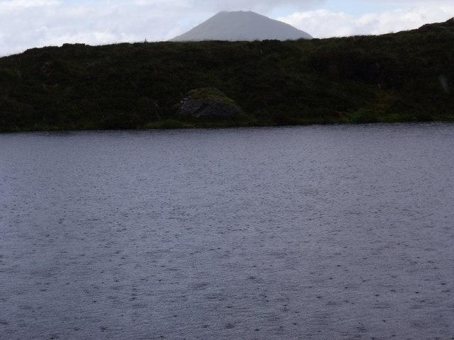Rain shower topping up Binnean nan Gobhar's lochan