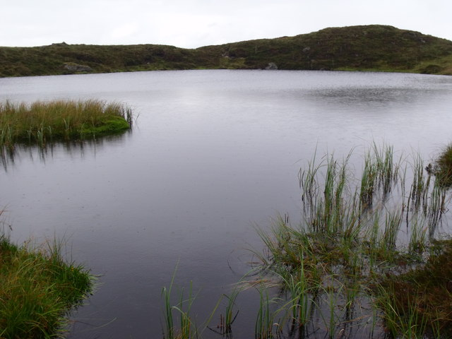 Lochan full to the brim north of Binnean nan Gobhar in Loch Ard Forest